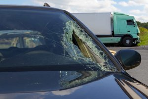 Car's windshield is broken after truck accident