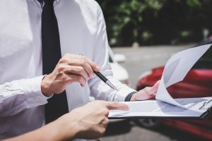Insurance agency reviews policy with accident victim